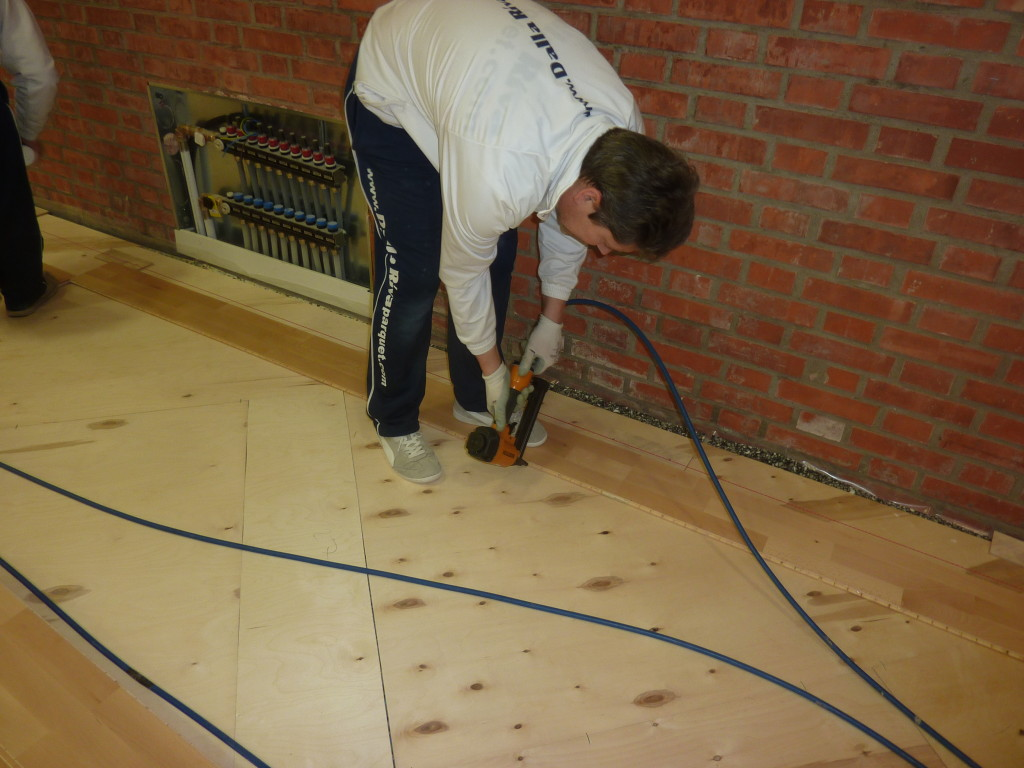 Technicians Dalla Riva Sportfloors during installation of sports flooring