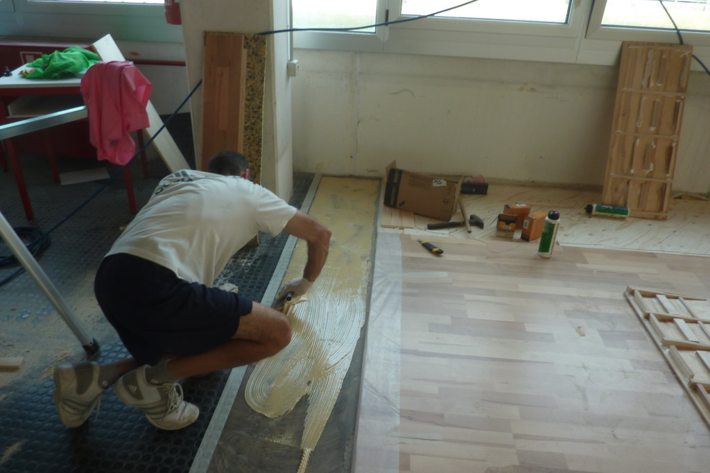 Other stages of installation of sports flooring in Friuli