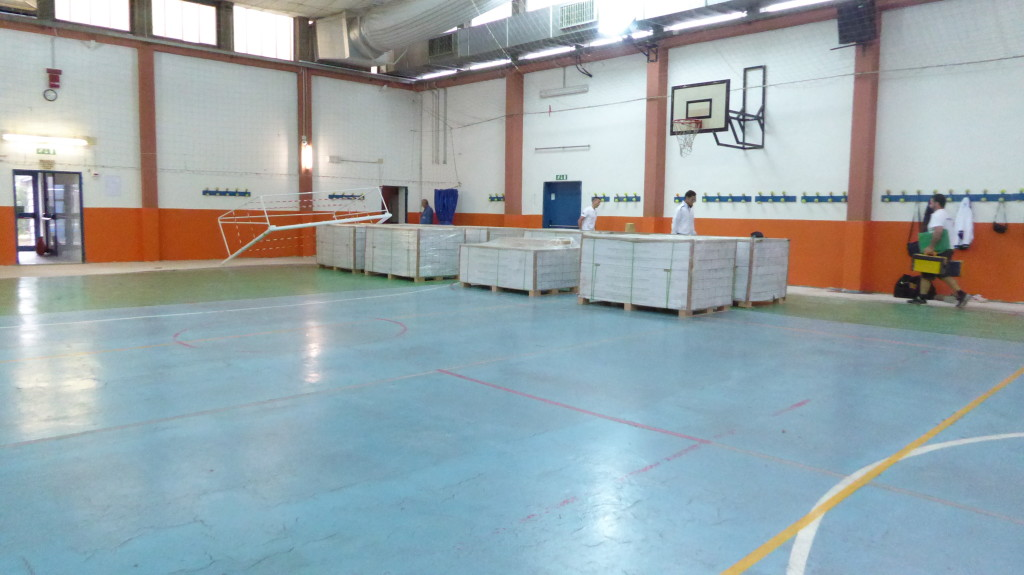 The preparation for the new installation of sports flooring in the great hall of Modena