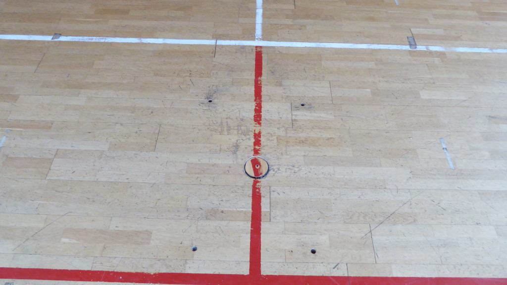 The signs of the time on the floor of a sports gym in the province of Bergamo subsequently renewed by Dalla Riva Sportfloors