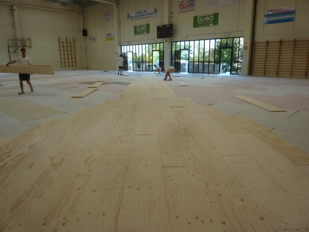 Early stages of laying the new sports parquet made in Montebelluna