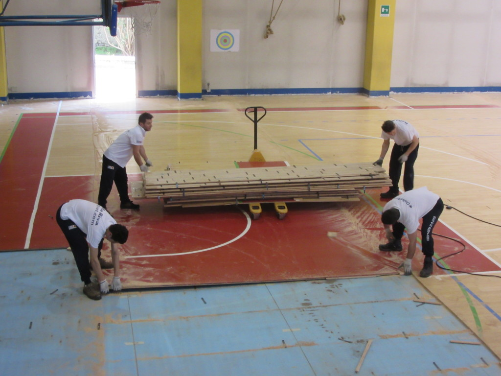 Removal steps of the old sports flooring of Riva del Garda