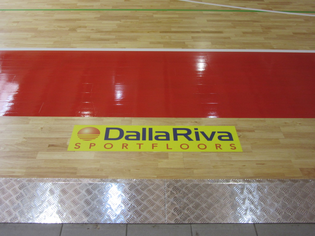 The distinctive logo Dalla Riva Sportfloors on new sports floor, a seal of the end of the works