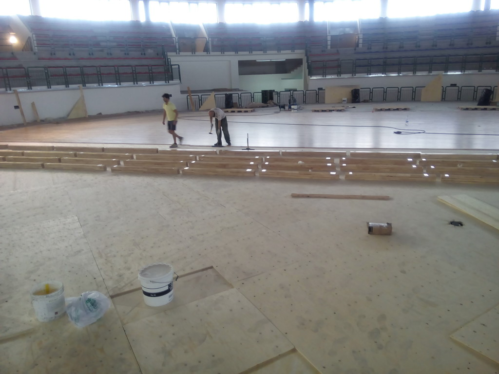 An image during the installation of sports flooring DR inside the sports hall of Milazzo