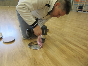 Technical Riva Sportfloors during the installation phase of the ferrules