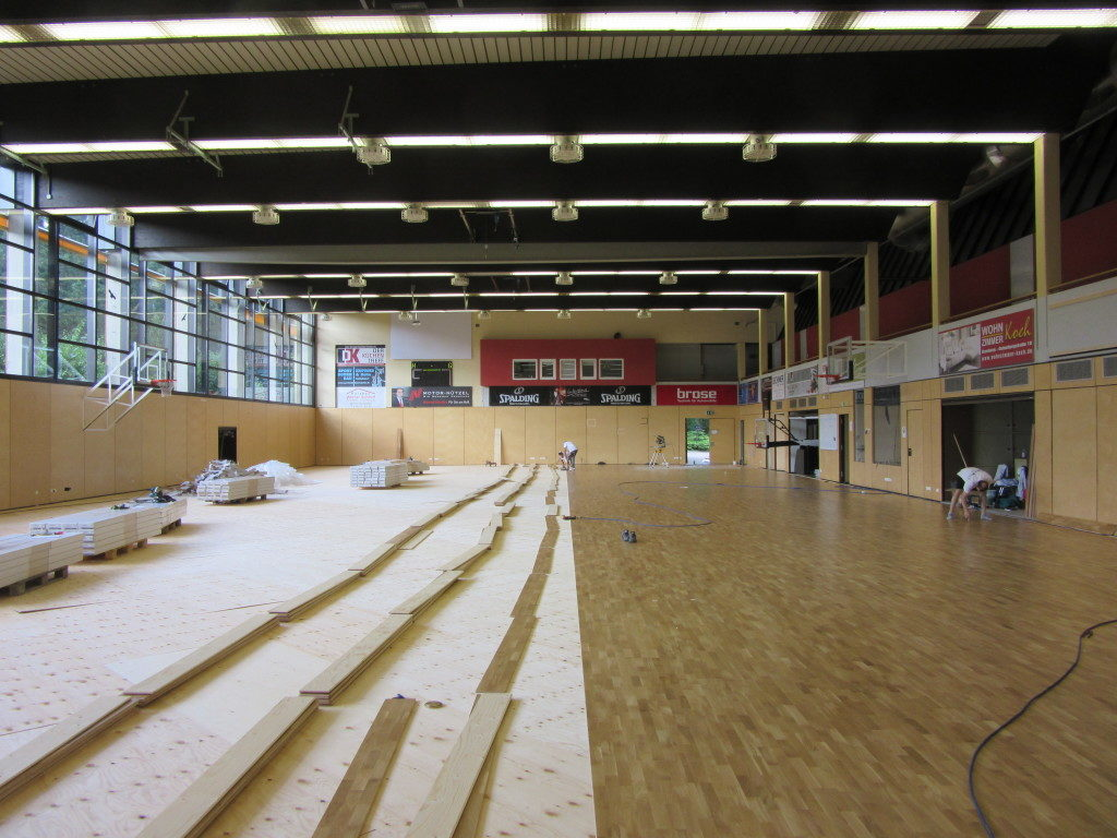 Stages of installation of the new oak floors in one of the gyms home of the Bamberg Basketball
