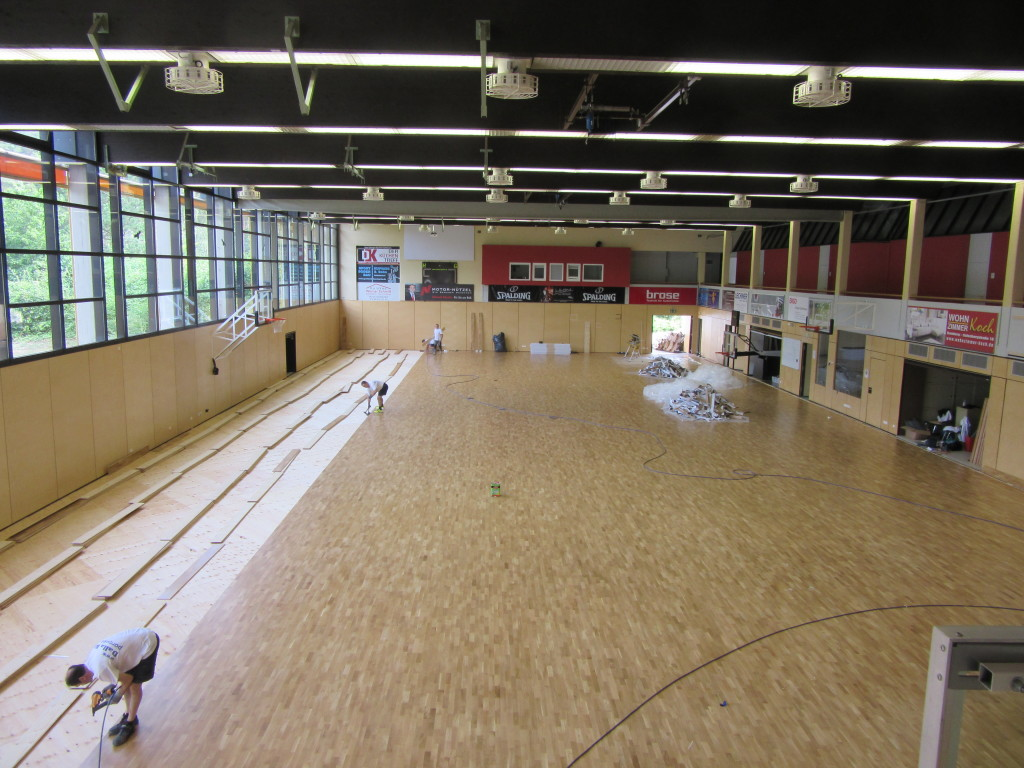 Italian coach and parquet for brose bamberg german champions for Sports flooring
