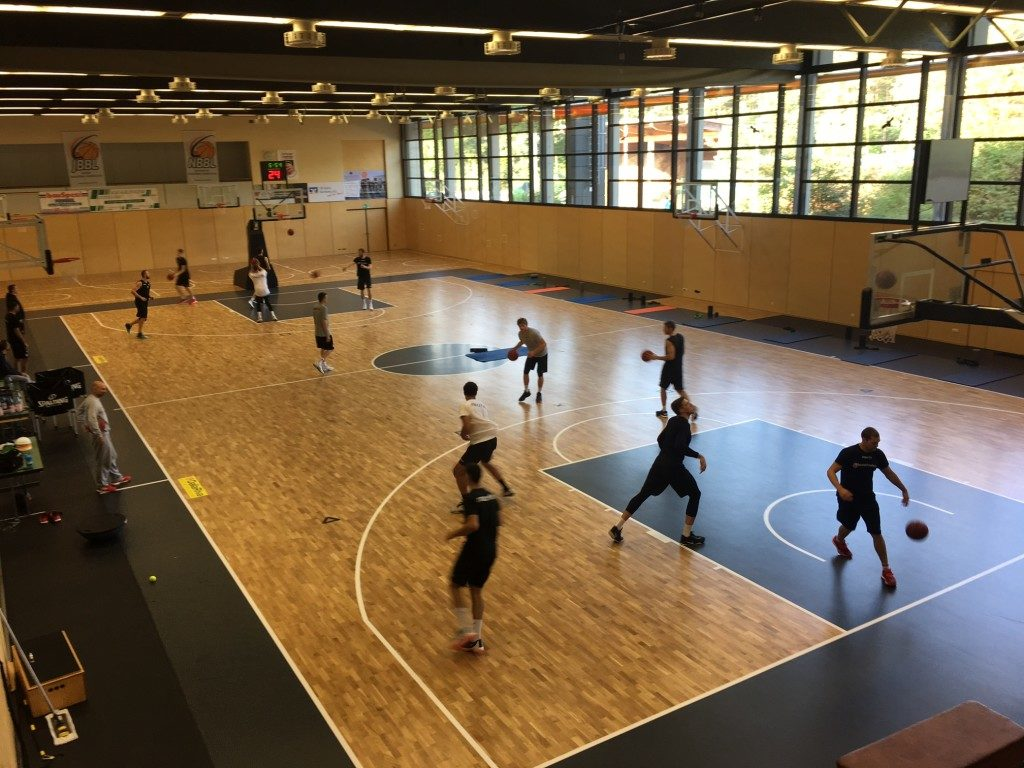 Players of the Brose Bamberg playing in the new gym with sports parquet Dalla Riva Sportfloors