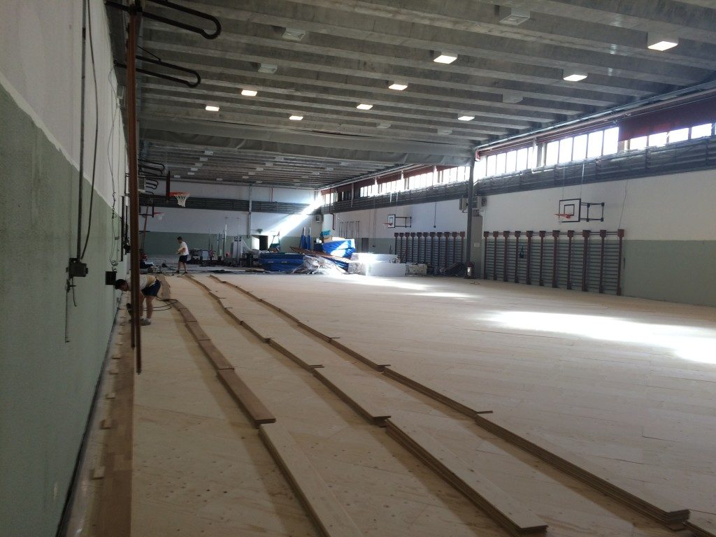 First strips in Beech of the new  sports flooring that Dalla Riva Sportfloors installed in Lecco