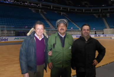 One of the staff responsible for the indoor stadium in Astana between Luigino Dalla Riva, on the left and Christian Bertolo