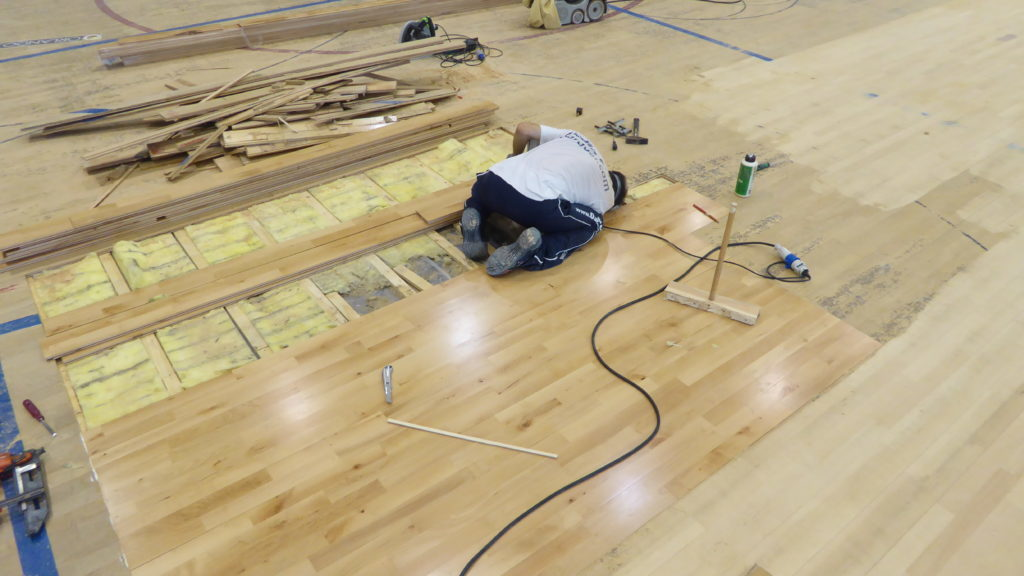 The skilled technicians engaged in the Tuscan sports hall