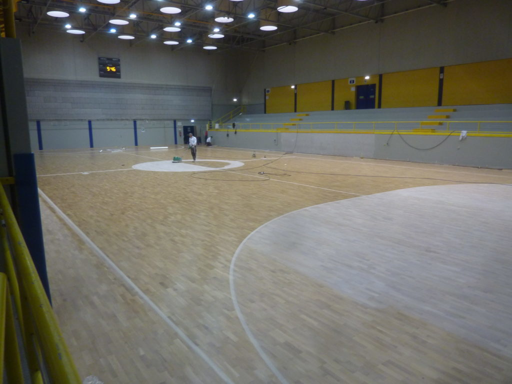 Technicinas of Dalla Riva Sportfloors at work during the markings of the playing fields