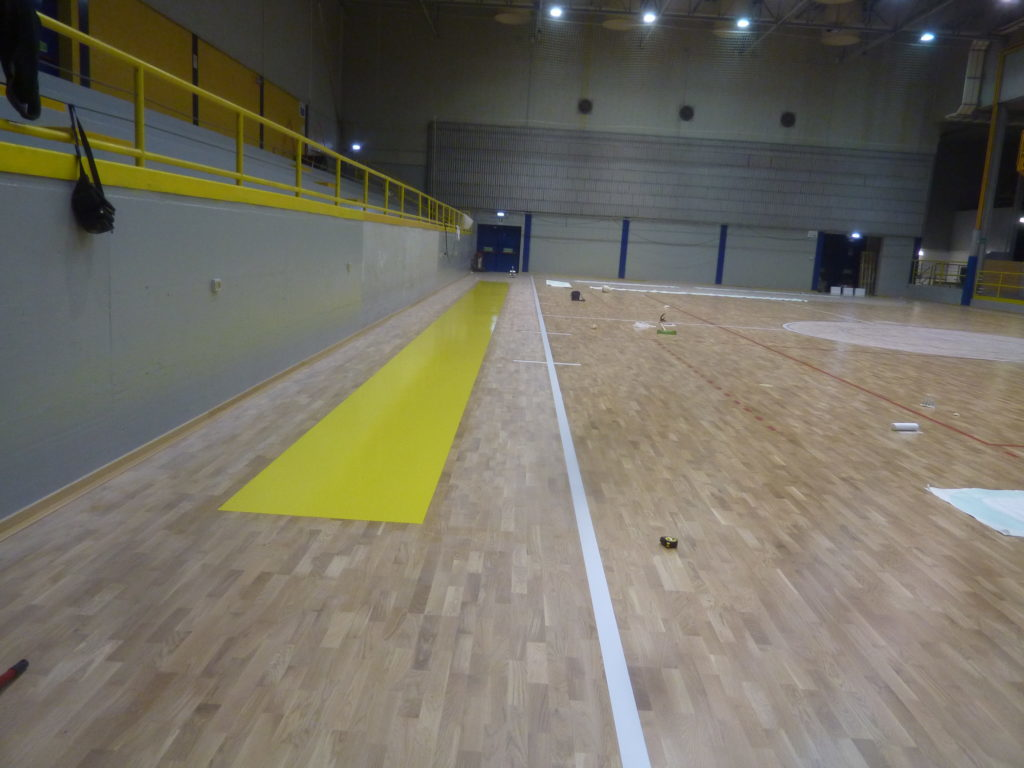 Some stages of customizing the sports parquet in Lignano Sabbiadoro