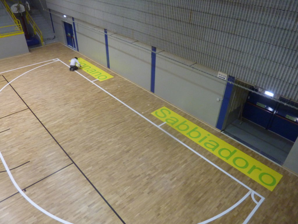 "Stages of laying one of the three enormous written ""Lignano Sabbiadoro"""