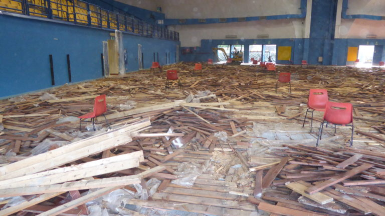 The remains of the old Le Cupole sports parquet ready to be transferred to the landfill