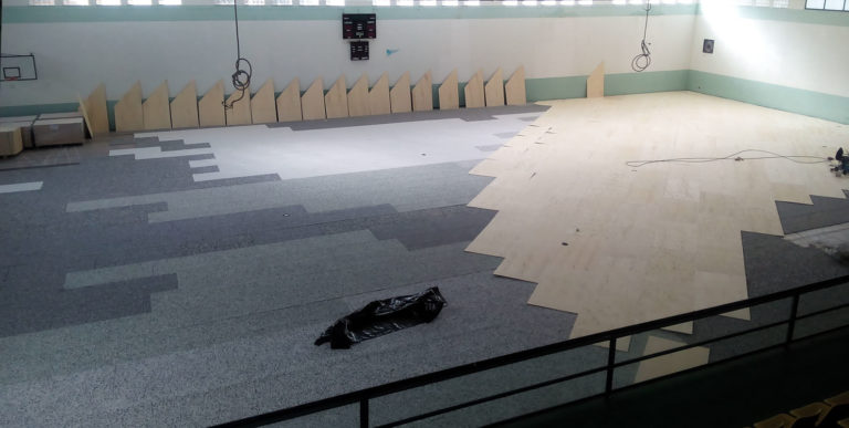 Laying phases of the new sports parquet in the sicilian palasport, after the elastic mat, a layer of conifer