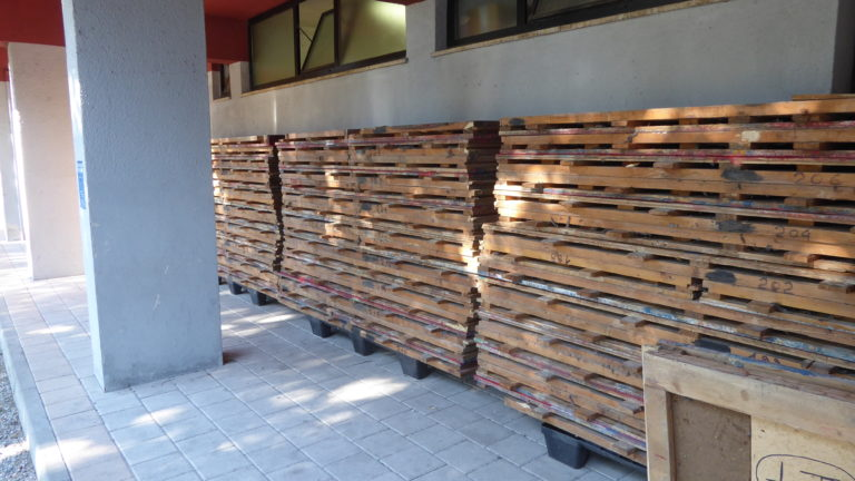 "The old parquet of the Cremona ""Spettacolo"" gym stacked outside"