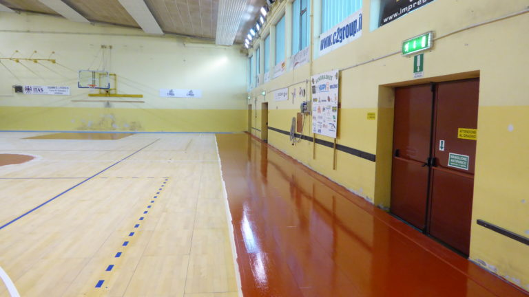 "For the new colors of the basketball areas, a lively red color ""Ral 3020"" was chosen"
