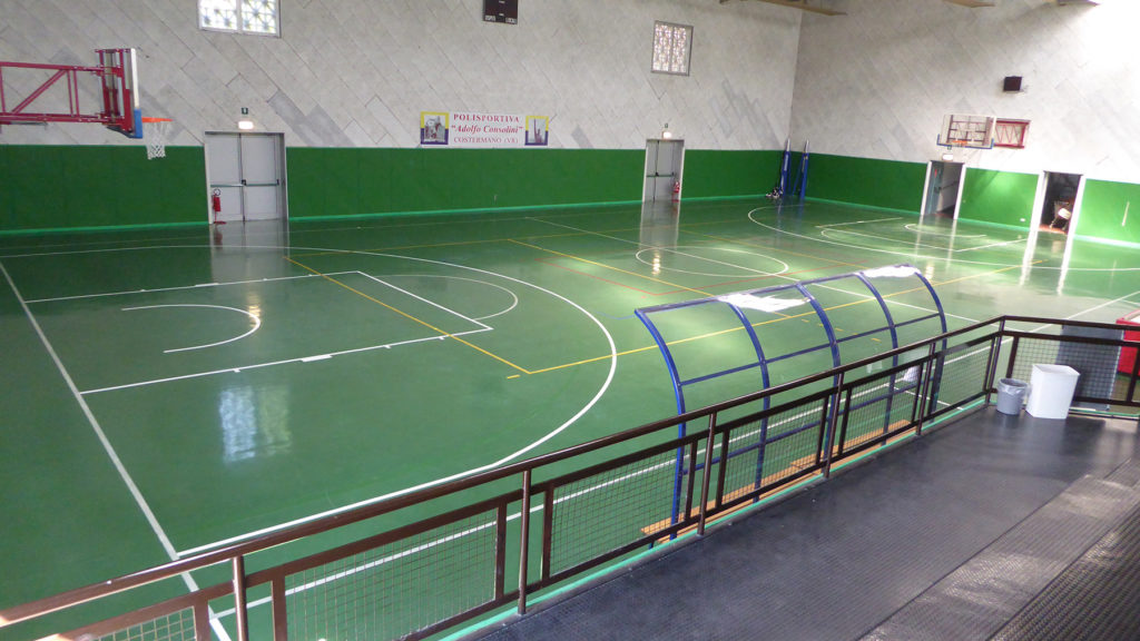 The previous hard rubber flooring; the Municipality wanted a flexible solution FIBA approved