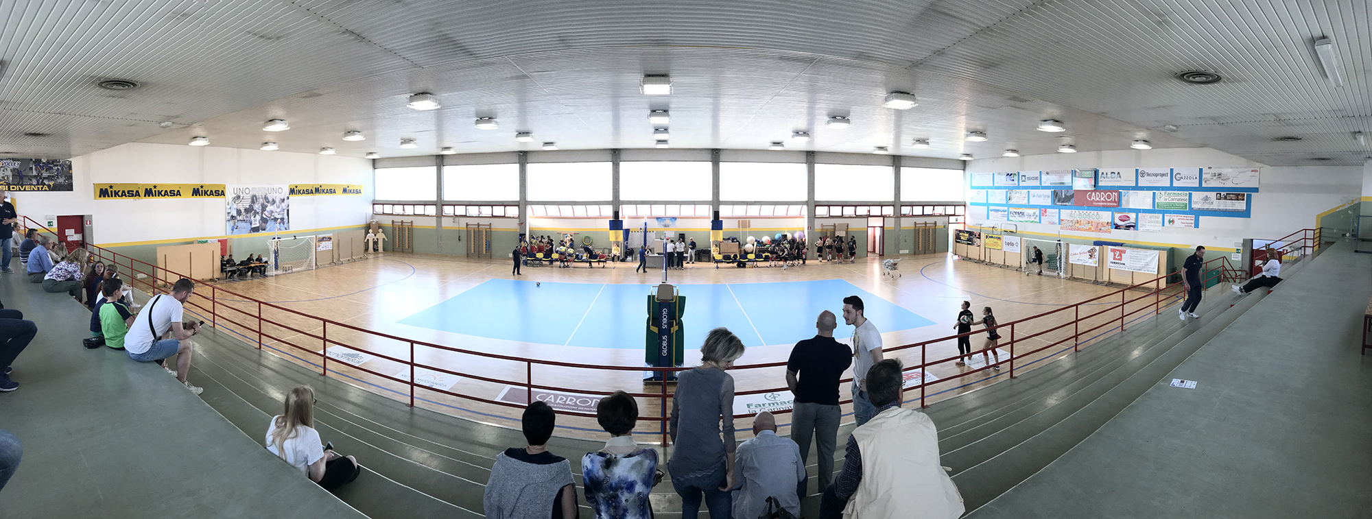 An overview of the sports facility, the celestial color of the volley stands out