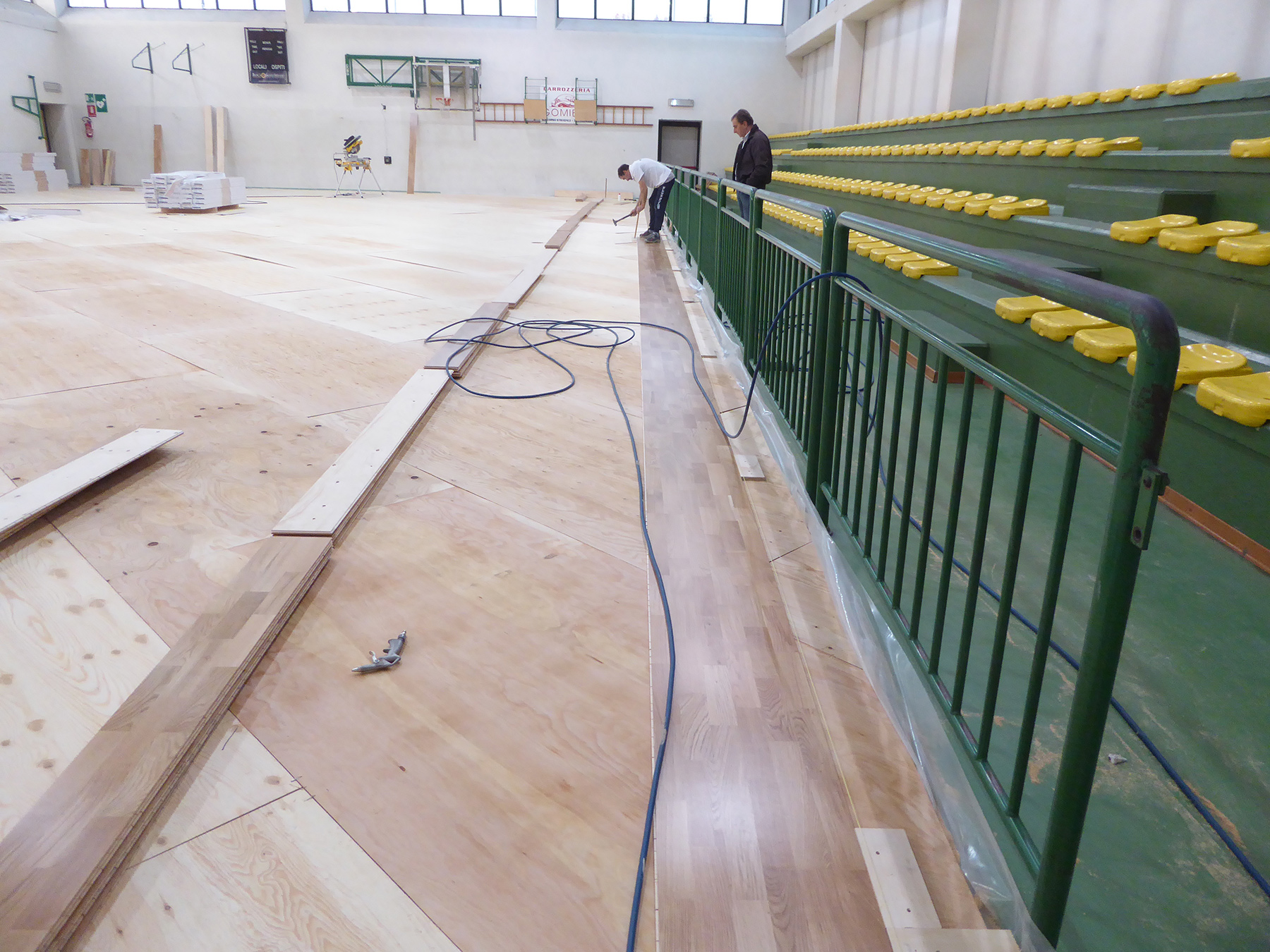 The beginning of the installation of FIBA approved parquet