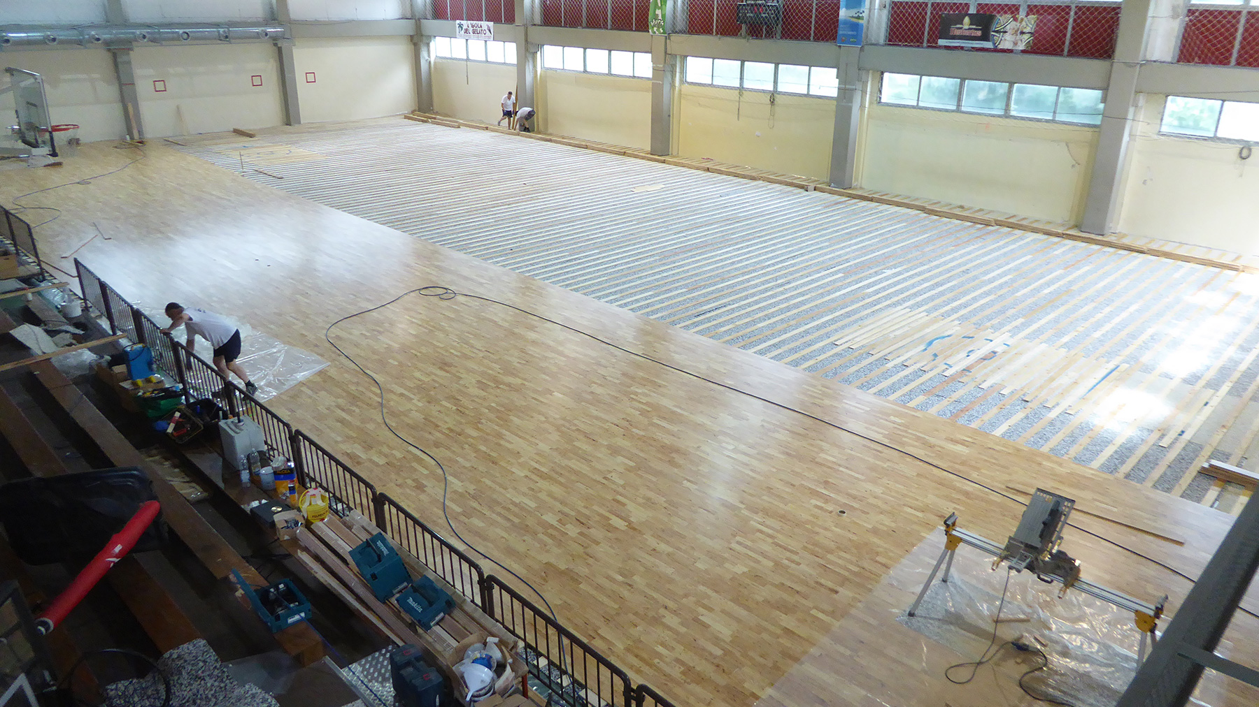 The technicians complete half the laying of the parquet