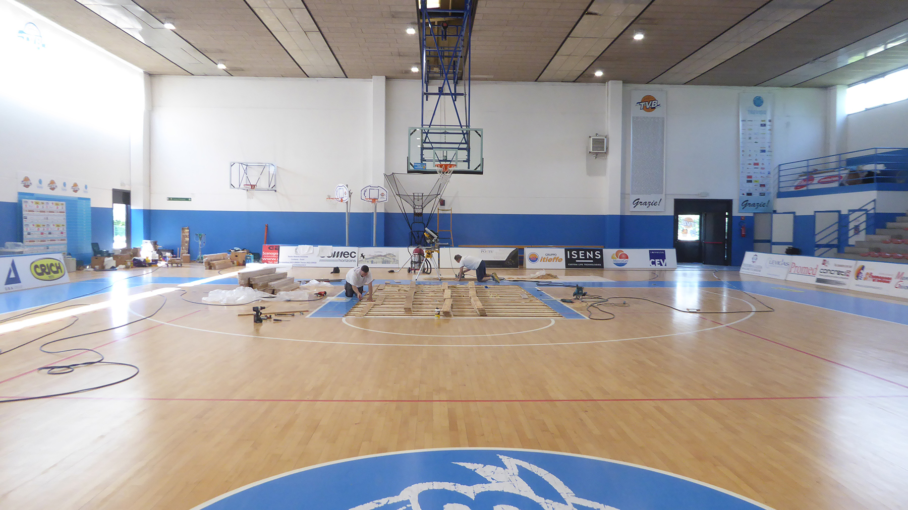 The technicians engaged with the laying of the parquet
