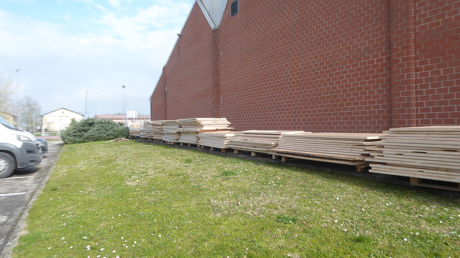 The old material stacked outside the sports facility