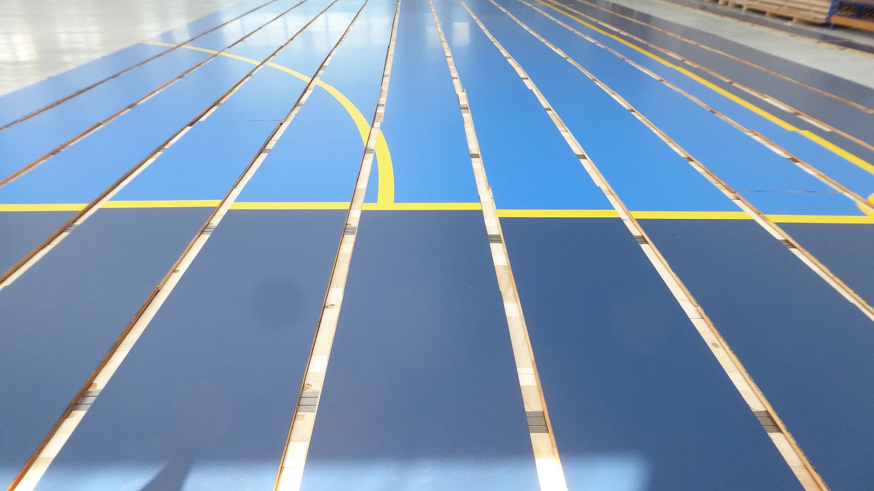 The individual panels of the removable parquet and the colors of the Swedish flag
