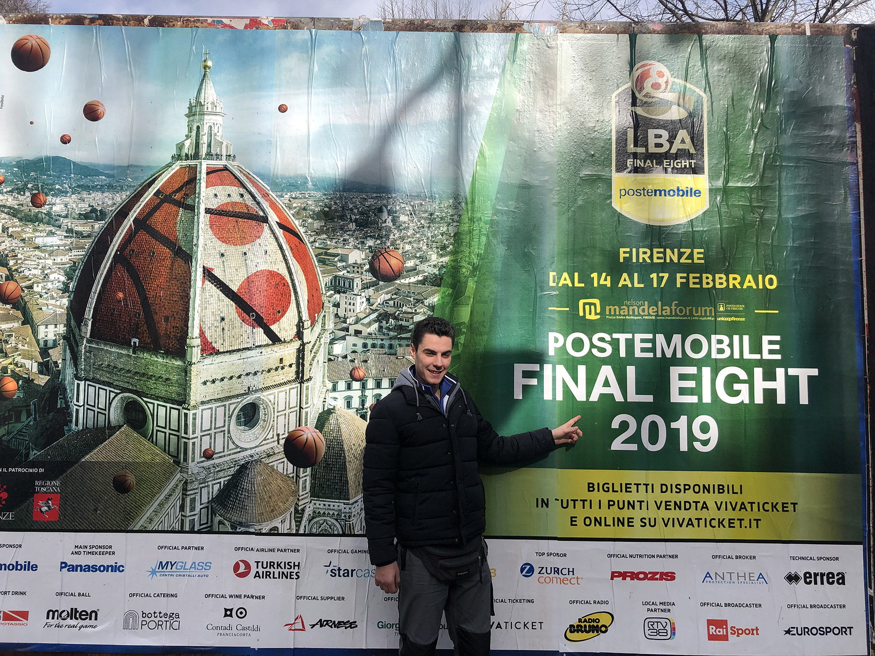 Marco Dalla Riva, one of our technicians, in front of the Lega billboard