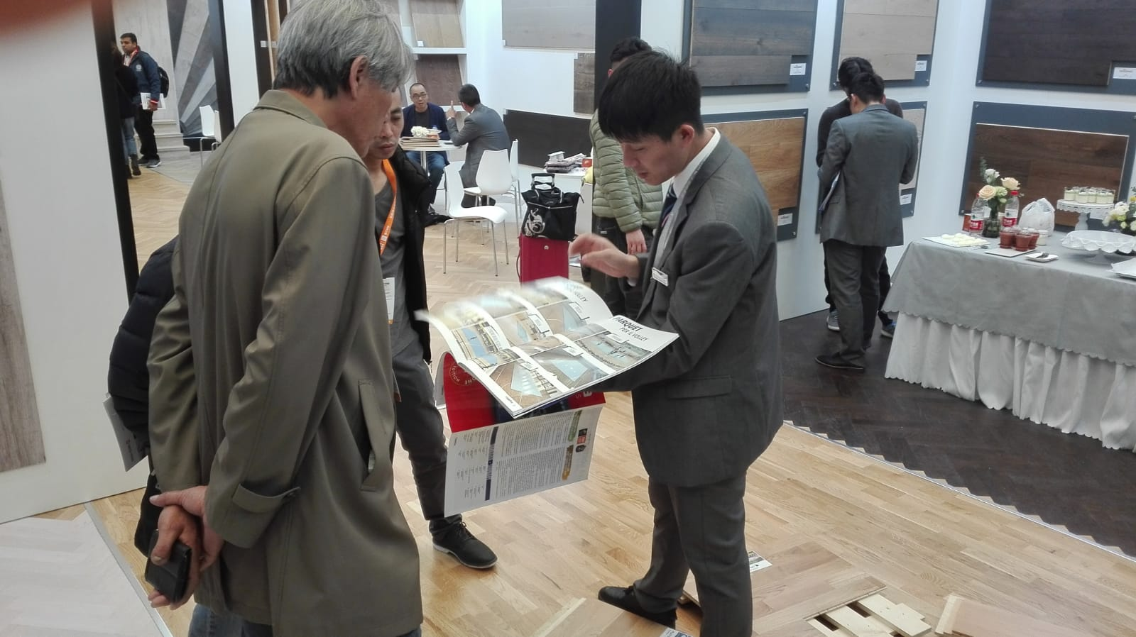 Some customers browse through the new Dalla Riva catalog
