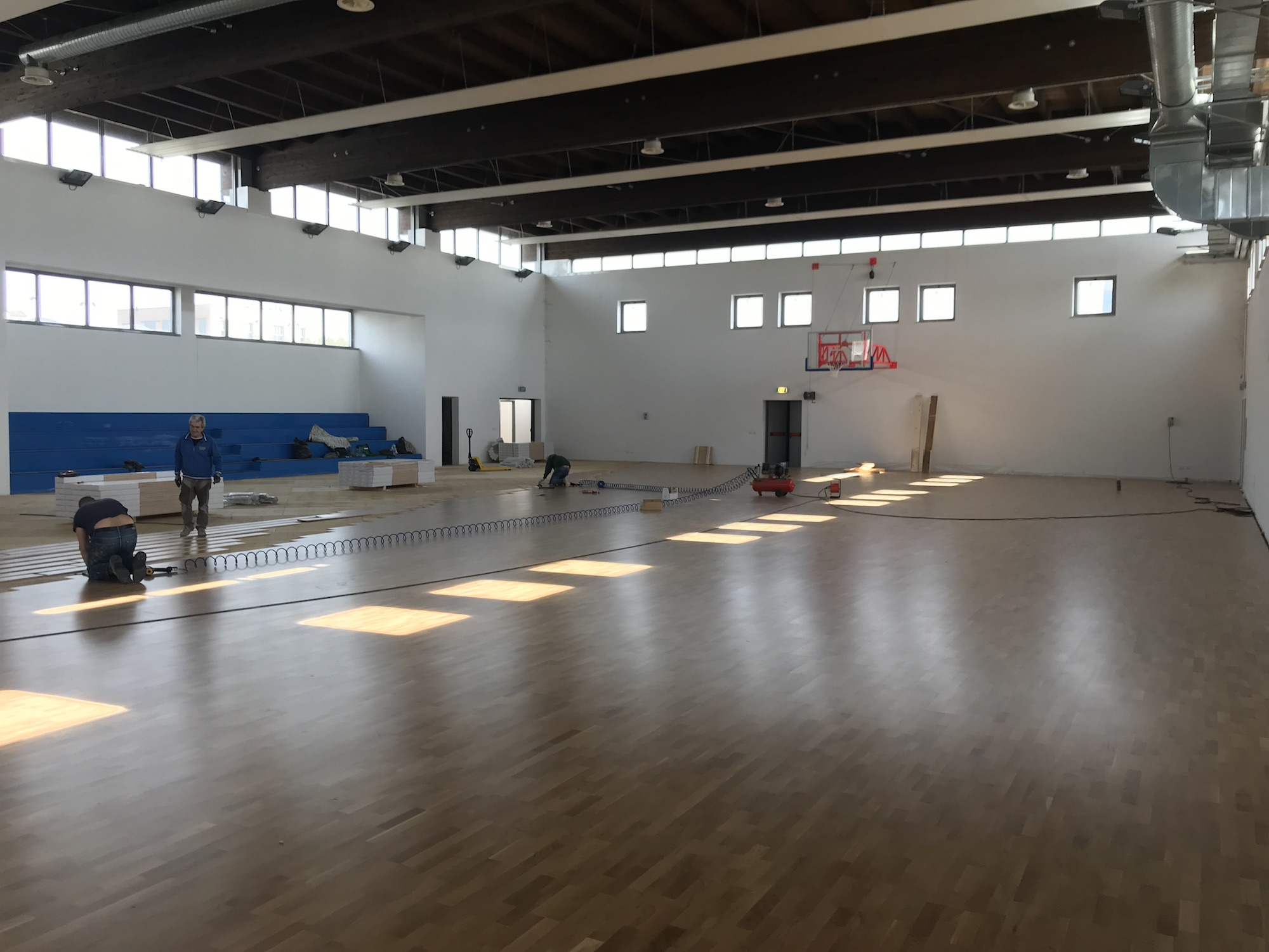 Laying of sports flooring
