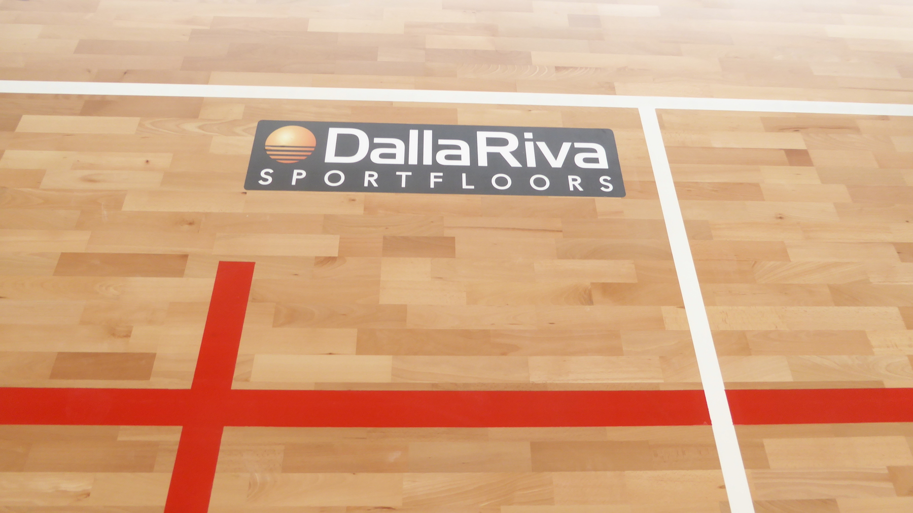 The emblem Dalla Riva Sportfloors on a black background