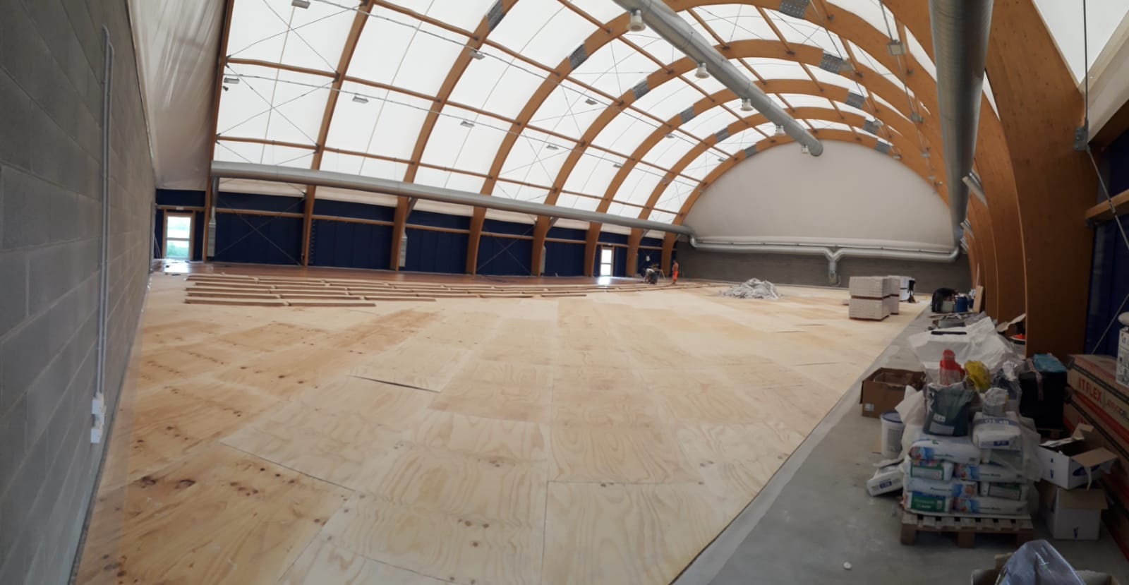 The stages of installation of sports parquet