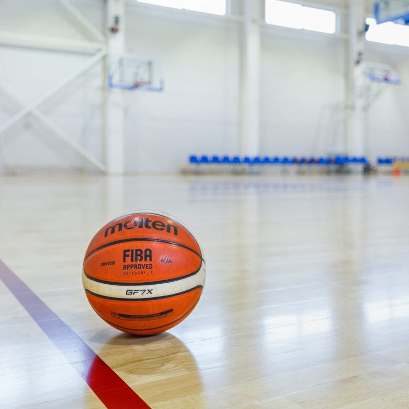 The details of the basketball and flooring
