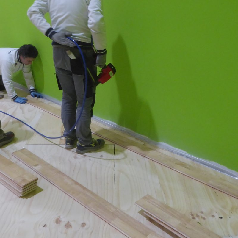 Our technicians work on the details when laying the parquet